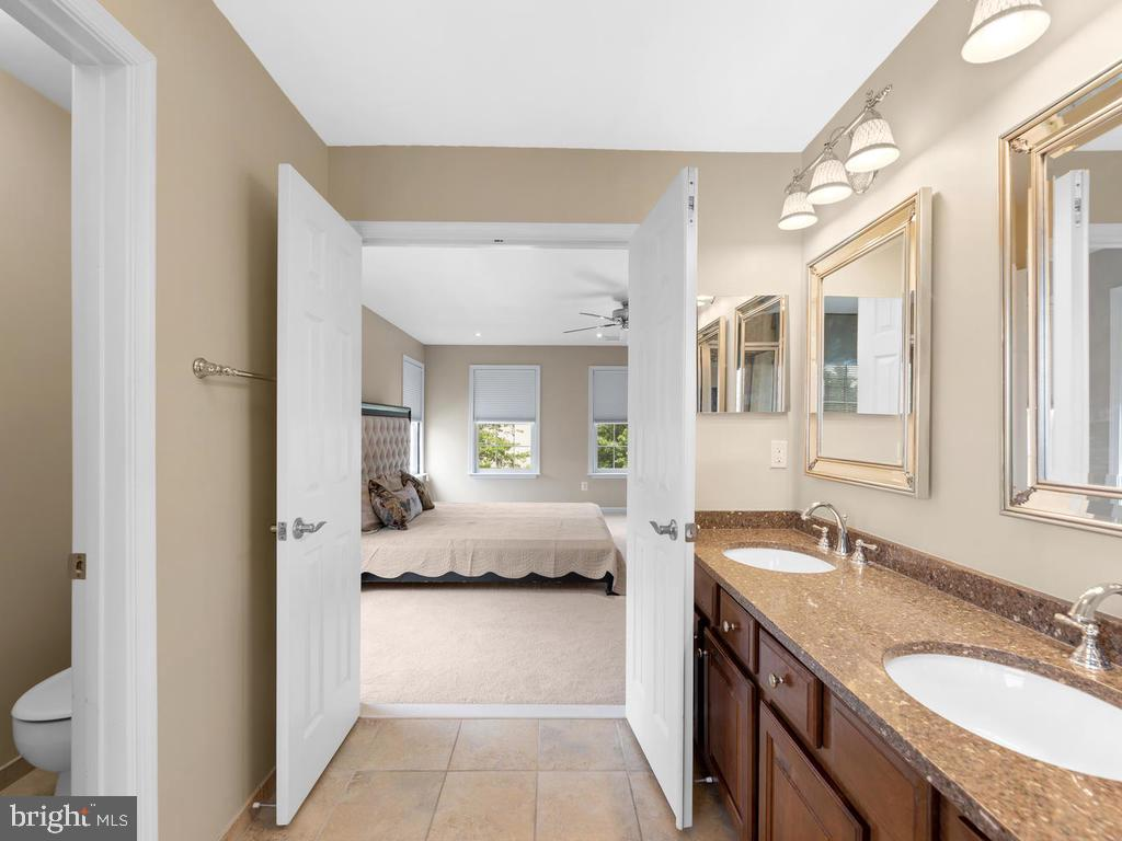 Water closet, double doors to master. - 358 SUGARLAND MEADOW DR, HERNDON