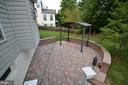 Paver patio with covering - 358 SUGARLAND MEADOW DR, HERNDON