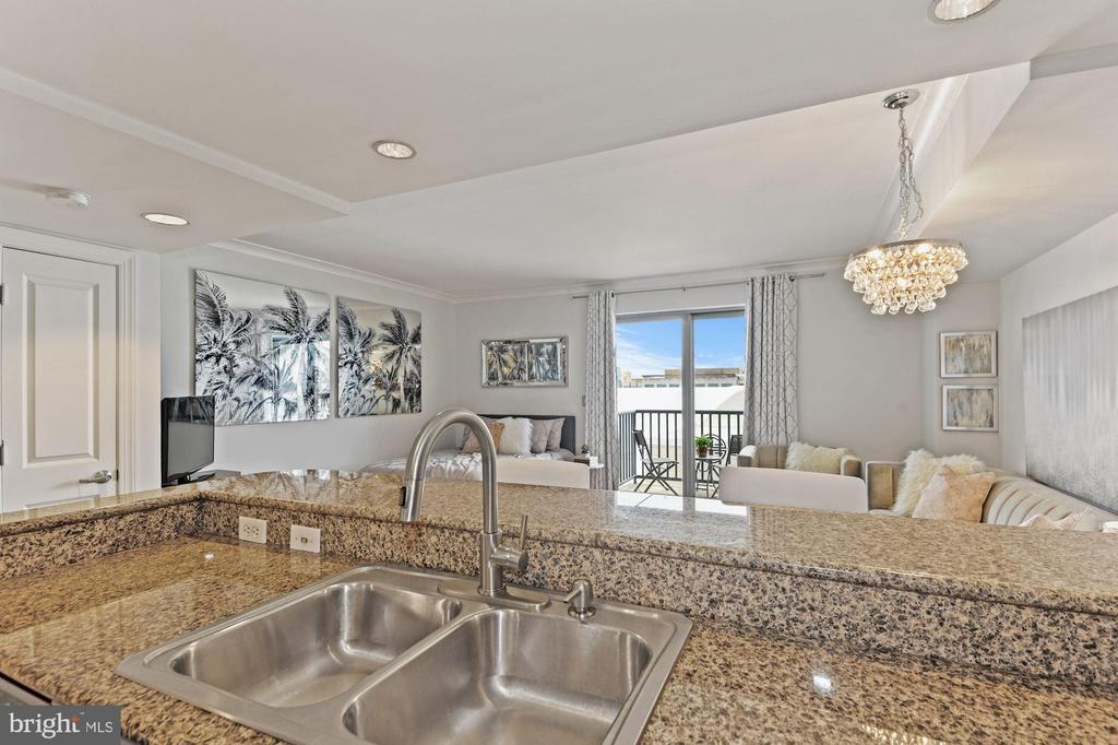 Spacious Kitchen Overlooks Living Area - 777 7TH ST NW #1102, WASHINGTON