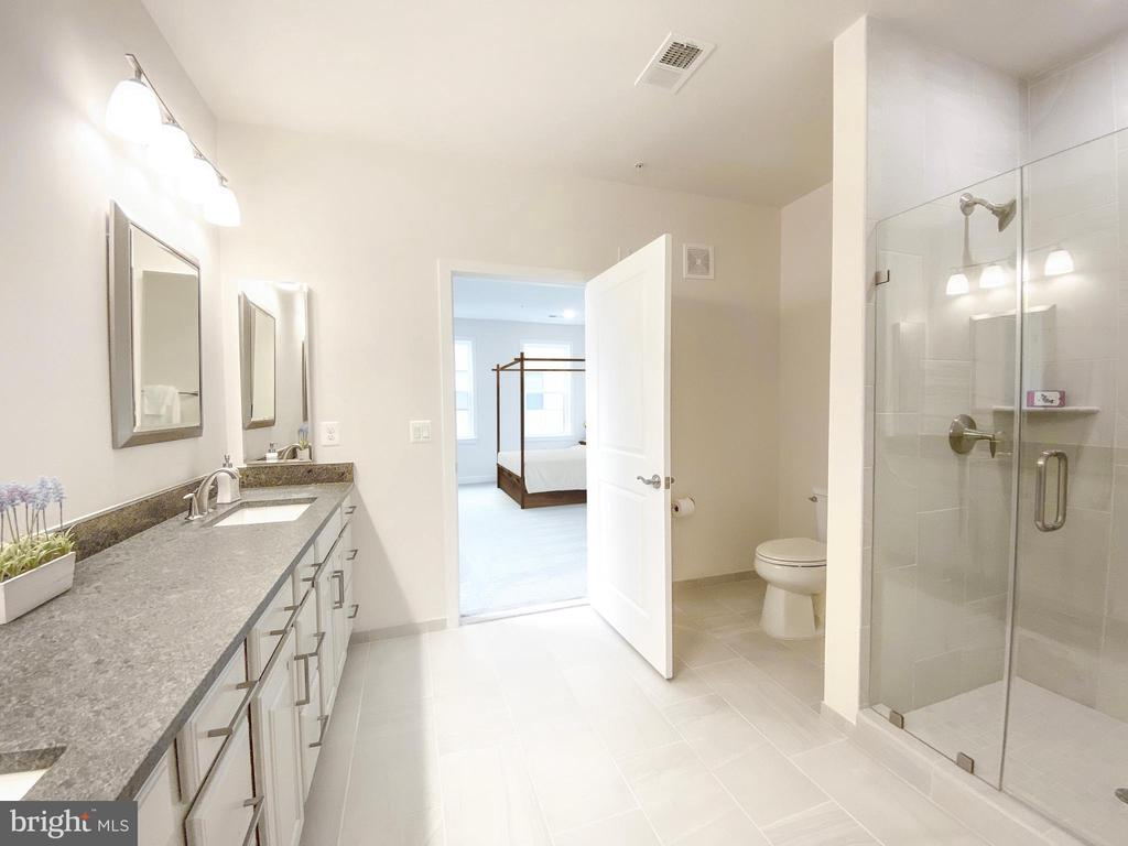 Stunning bathroom with two sinks and granite - 43091 WYNRIDGE DR #301, BROADLANDS