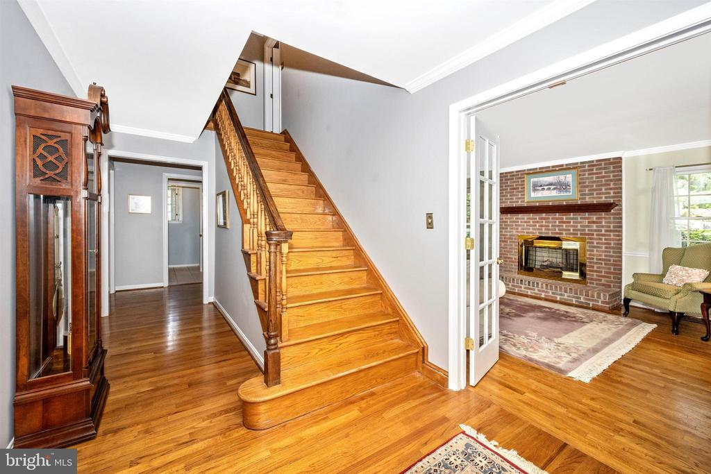 Rich hardwood floors in the homes foyer - 8707-A N PACIFIC CT, MIDDLETOWN