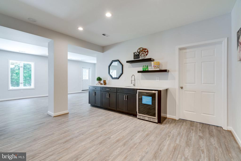 Luxury Vinyl Plank flooring throughout basement - 11112 HAMPTON RD, FAIRFAX STATION