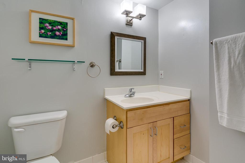 Bathroom has a heat lamp and new faucet. - 7981 EASTERN AVE #202, SILVER SPRING