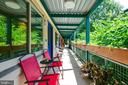 Unit looks out to trees and plantings. - 7981 EASTERN AVE #202, SILVER SPRING
