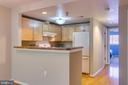 Breakfast bar separates living room from kitchen. - 7981 EASTERN AVE #202, SILVER SPRING