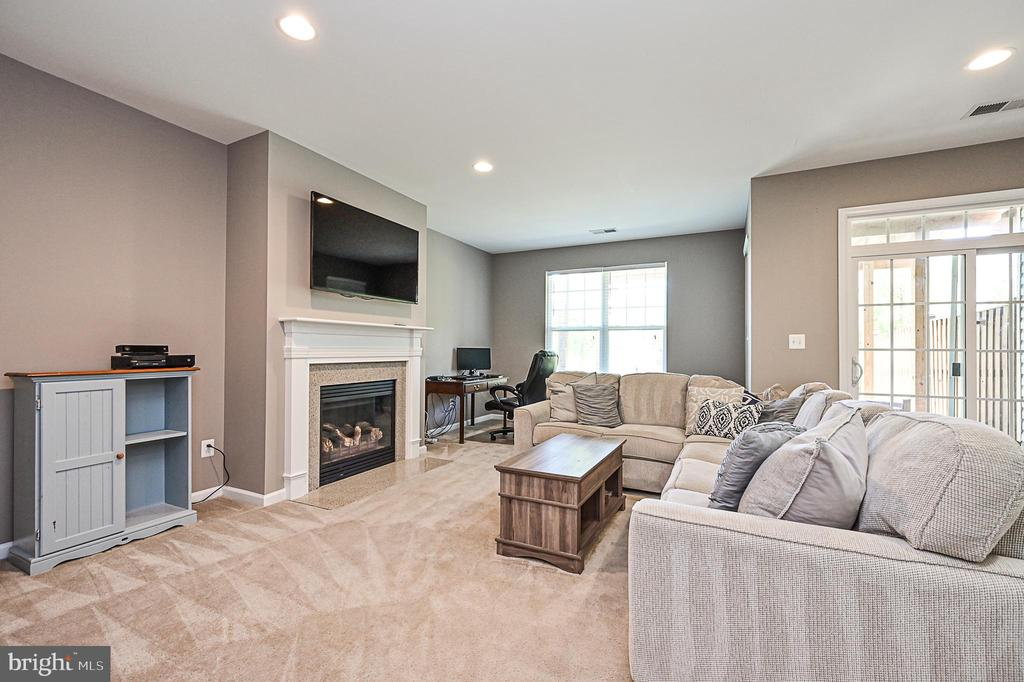 Family room with gas fireplace. - 42297 DEMARCO TER, CHANTILLY