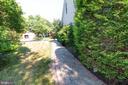 paver walkway on side of house - 1302 WANETA CT, ODENTON