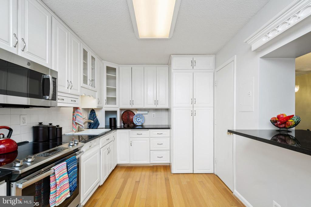 Kitchen has been opened up & renovated - 5902 MOUNT EAGLE DR #609, ALEXANDRIA