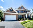 Chapel Grove 2 car garage, brick front home - 1410 MACFREE CT, ODENTON
