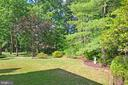 Backyard with Mature Trees & Green Space - 14504 S HILLS CT, CENTREVILLE