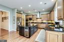 Center island has built-in beverage fridge - 904 LOCUST ST, HERNDON