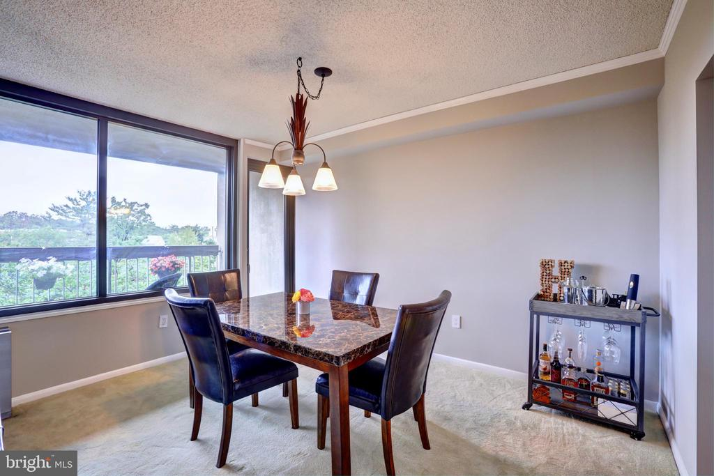 Dining room with new balcony door in 2015 - 3701 S GEORGE MASON DR #409N, FALLS CHURCH