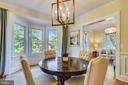 Dining  Room with newer windows, elegant lighting - 840 ELDEN ST, HERNDON