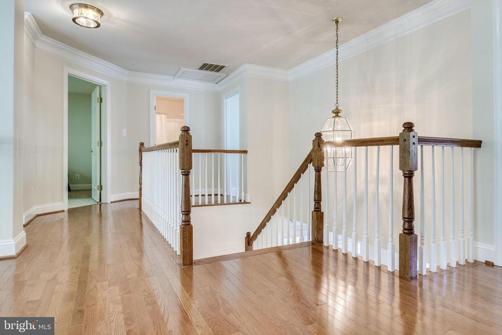 Upper Level Hallway with Mosaic Hardwood Floors - 3720 SPICEWOOD DR, ANNANDALE
