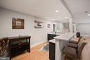 Bar with granite and custom cabinets and shelves - 5631 SOUTHAMPTON DR, SPRINGFIELD