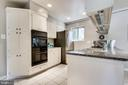Crisp, white cabinetry and lovely granite counters - 5000 FLEMING DR, ANNANDALE
