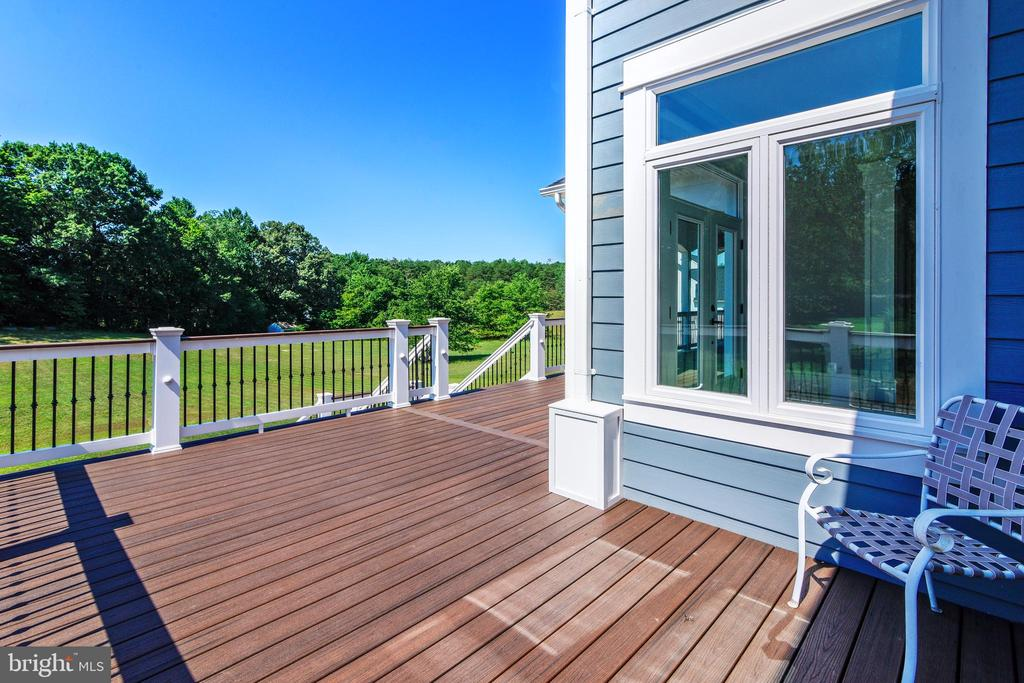 Large back deck that covers the entire main floor - 14612 BRISTOW RD, MANASSAS