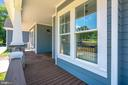 Large front porch with Trex flooring in Spiced Rum - 14612 BRISTOW RD, MANASSAS