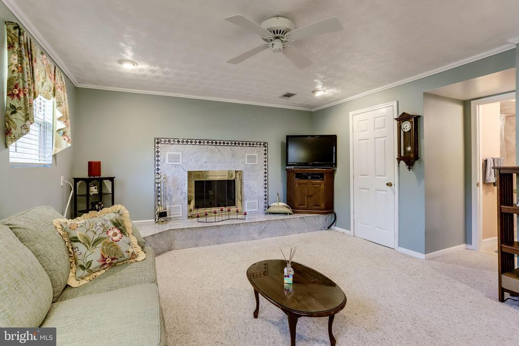 Warm up by the wood-burning fireplace - 128 N GARFIELD RD, STERLING