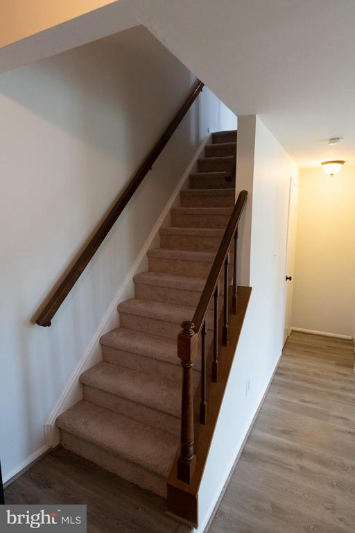 Newly carpeted stairs leading to sleeping quarters - 1004 WARWICK CT, STERLING