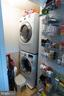Laundry space w/ storage tucked away from view - 1004 WARWICK CT, STERLING