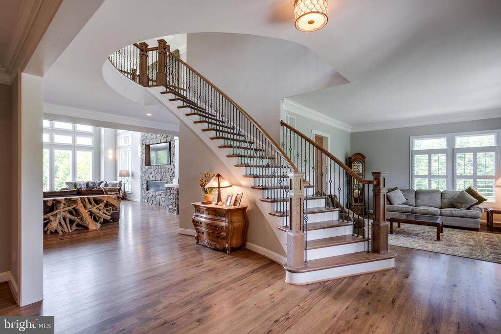 Grand Rod Iron Curved Staircase - 41820 RESERVOIR RD, LEESBURG