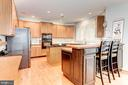 Kitchen with Breakfast Bar - 26048 IVERSON DR, CHANTILLY
