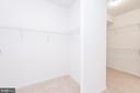 Primary bedroom walk-in closets with carpeting - 6033 SUMNER RD, ALEXANDRIA