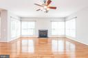 Living room with gas fireplace and ceiling fan - 6033 SUMNER RD, ALEXANDRIA