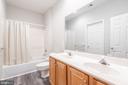Left hallway full bathroom with double vanity - 6033 SUMNER RD, ALEXANDRIA