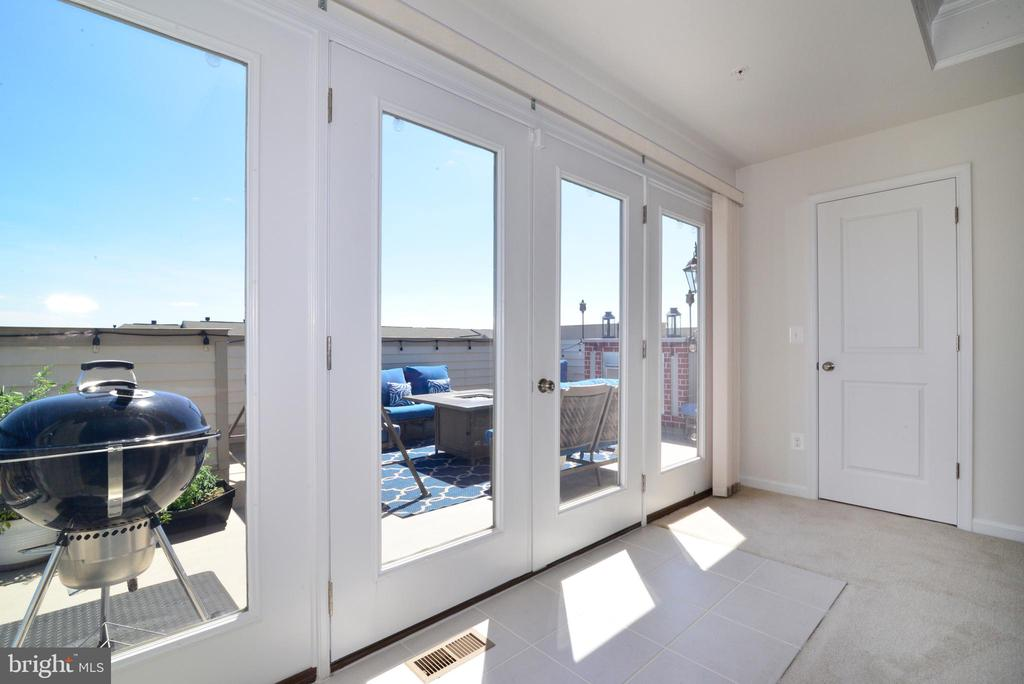 Fabulous French doors to the deck - 23398 EPPERSON SQ, BRAMBLETON