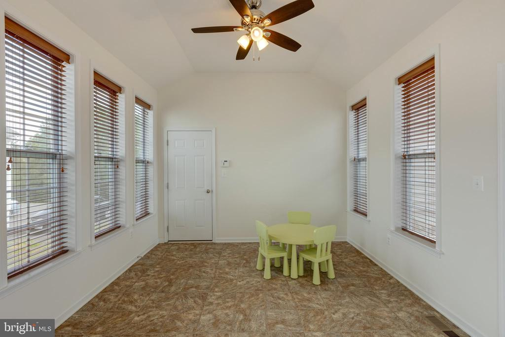 Sun room off of garage with access to rear deck. - 43172 ASHLEY HEIGHTS CIR, ASHBURN