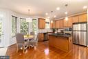 Kitchen w/ casual dining - 7142 DEGROFF CT, ANNANDALE