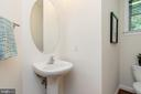 Convenient main level powder room - 7142 DEGROFF CT, ANNANDALE