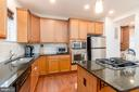 Large kitchen with island - 7142 DEGROFF CT, ANNANDALE