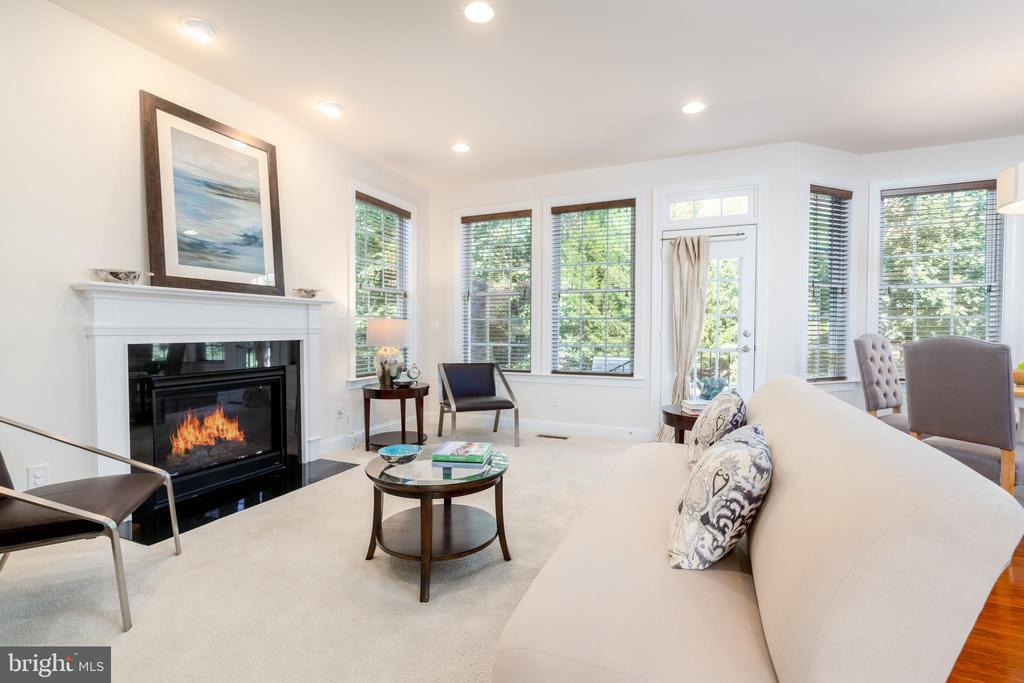 Family room open to kitchen w/ gas fireplace - 7142 DEGROFF CT, ANNANDALE