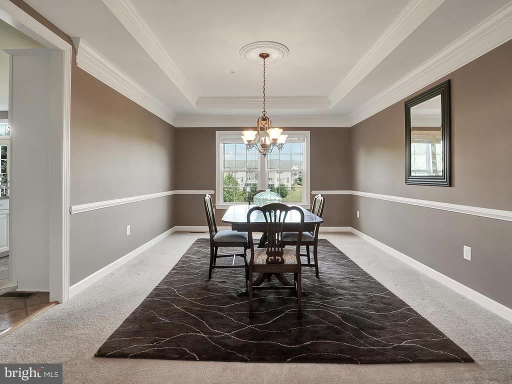 Spacious dining room for entertaining. - 9509 TOTTENHAM CIR, FREDERICK