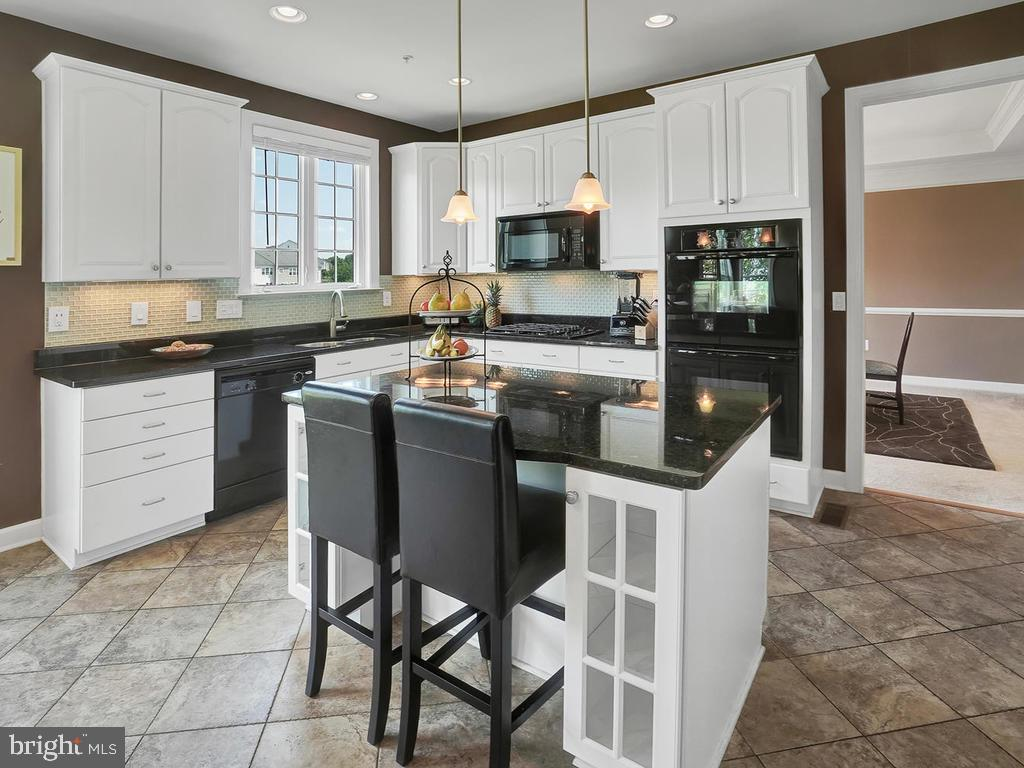 Kitchen with white cabinets! - 9509 TOTTENHAM CIR, FREDERICK