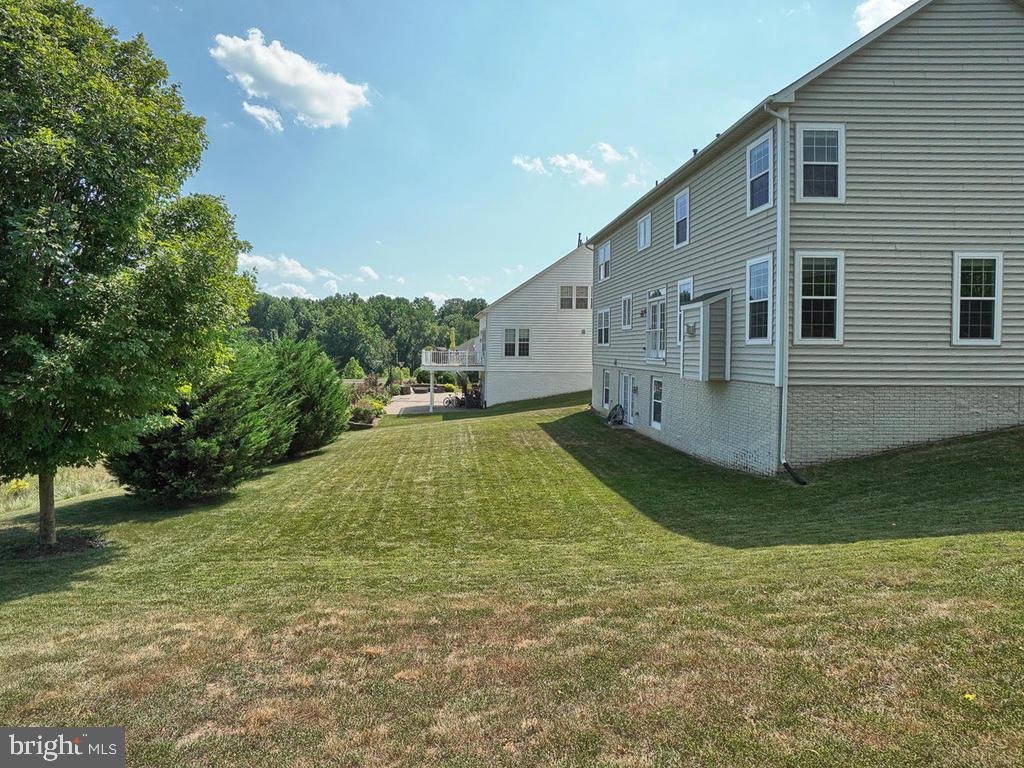 This backyard is perfect for playing sports! - 9509 TOTTENHAM CIR, FREDERICK