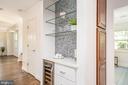 Dry bar w/ herringbone tile backsplash - 3506 7TH ST N, ARLINGTON