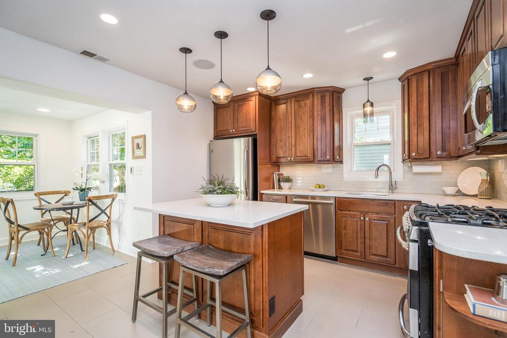 Renovated kitchen with island & heated floors - 3506 7TH ST N, ARLINGTON