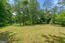 view of lake and lawn - 7304 BACKLICK RD, SPRINGFIELD