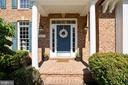 COVERED PORTICO AND BRICK LANDING ENTRY - 6444 ROCK HOLLOW LN, CLIFTON