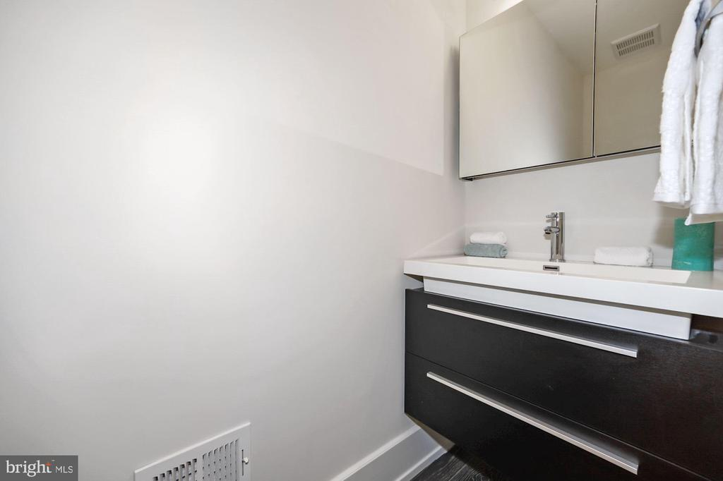 Powder room off of living room and kitchen - 407 RANDOLPH ST NW #1, WASHINGTON