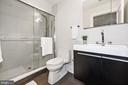 Sleek and modern bathroom with designer shower - 407 RANDOLPH ST NW #1, WASHINGTON