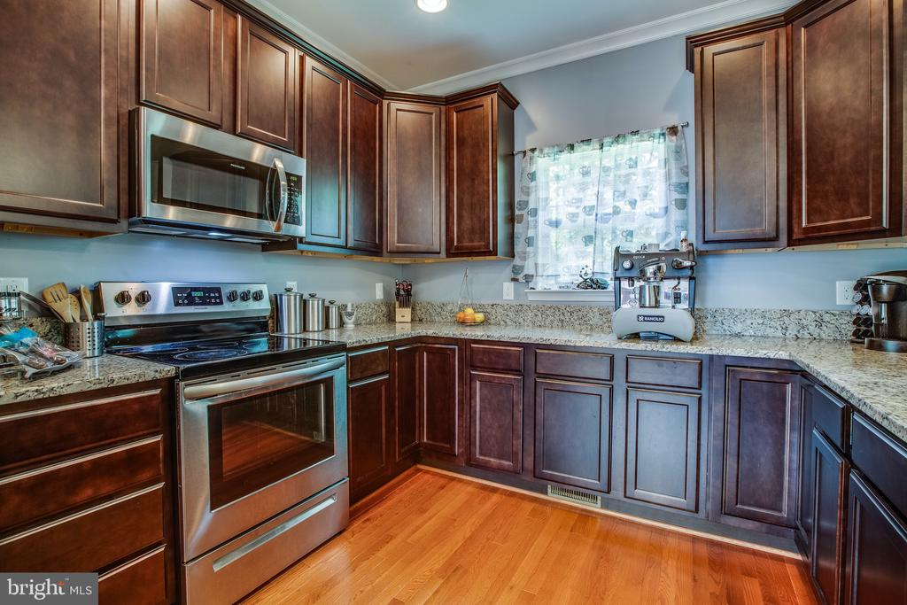 Those cabinets! Gorgeous! - 3110 RIVERVIEW DR, COLONIAL BEACH