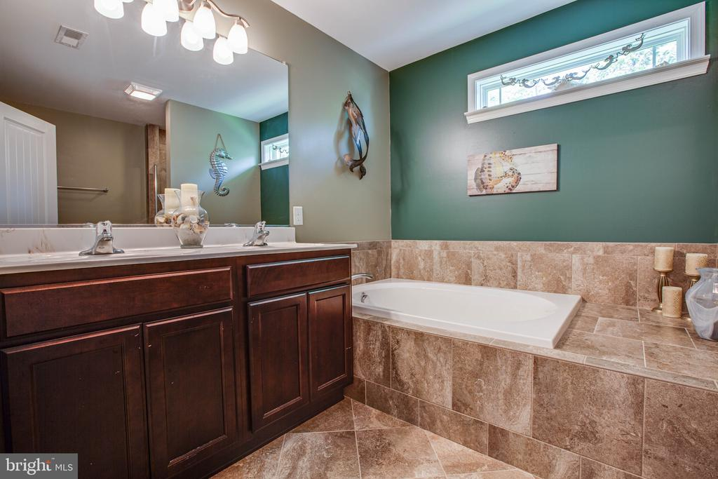The elegant bathroom with tile & double vanity - 3110 RIVERVIEW DR, COLONIAL BEACH
