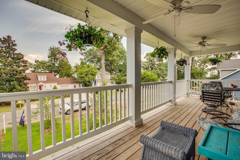 This upper porch offers 2 ceiling fans for breeze - 3110 RIVERVIEW DR, COLONIAL BEACH