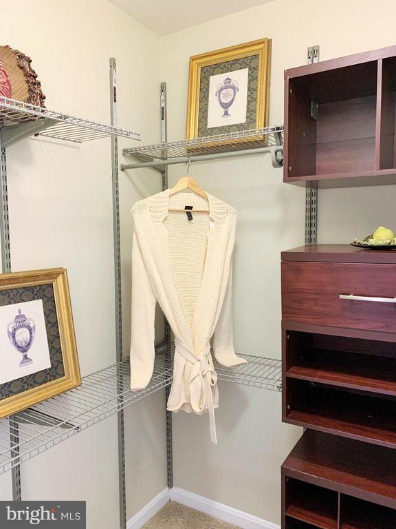 Master bedroom walk in closet - 43193 CARDSTON PL, LEESBURG