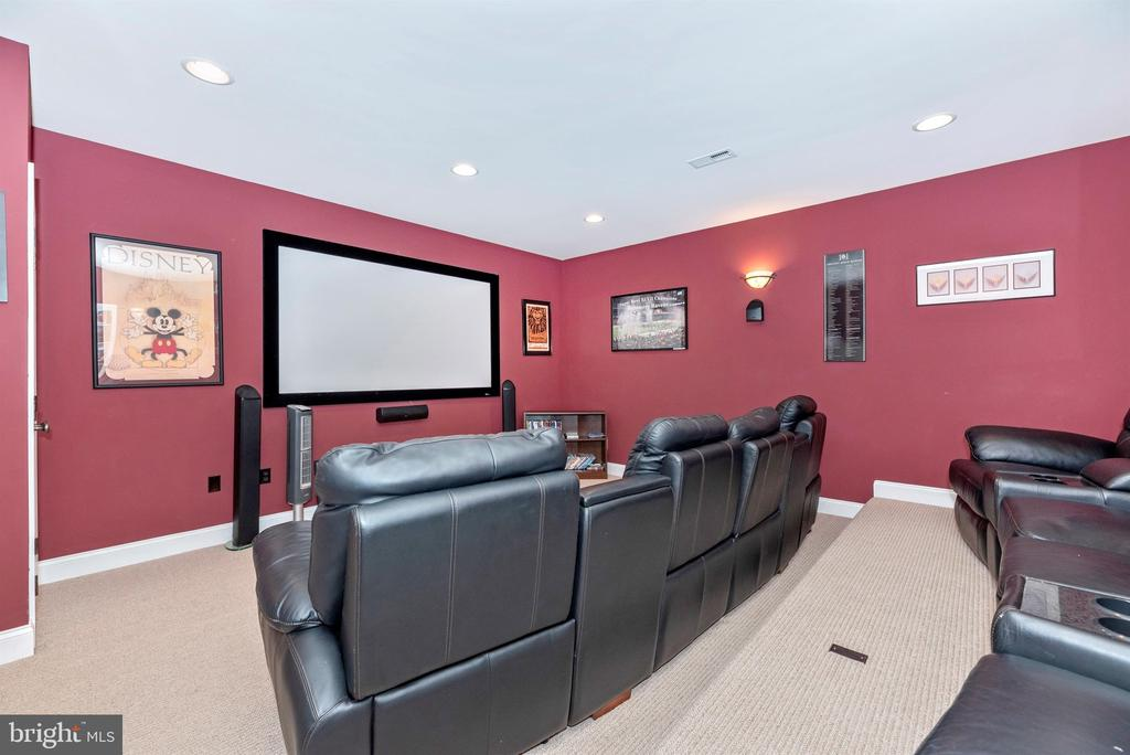Home theater with custom seating to convey - 12788 BARNETT DR, MOUNT AIRY